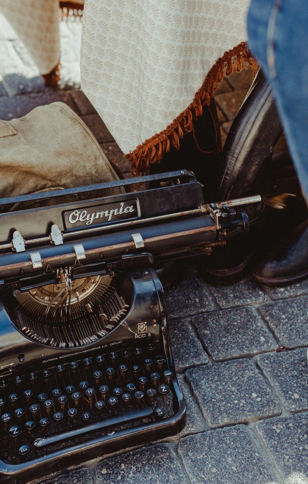 black Olympia typewriter on floor