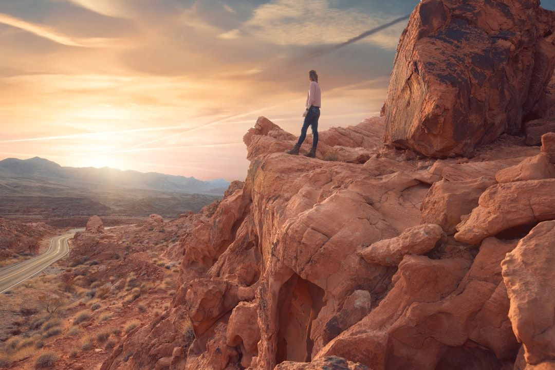 man standing on rock formations
