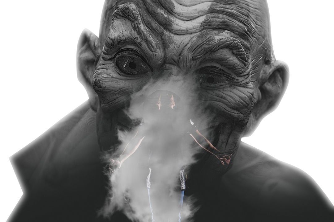 person standing near smoke with black background